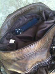 A small pocket inside a larger purse is a safer place to store the working wallet