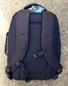 Back of pack showing rain jacket stored in strap area.